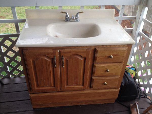 Oak bathroom sink cabinet vanity with lower drawer for Furniture federal way
