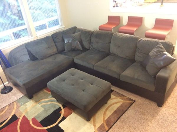 Grey microfiber and leather sectional couch with ottoman for Furniture in bellevue