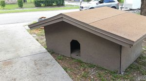 Dog house we built this like a house it's 4 ft by 7 ft we can cut the door to whatever size and it is vented through the roof