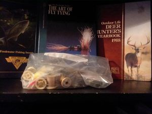 Freshwater fisherman and secrets and a book Art of fly fishing a nd supplies to make a few yourself