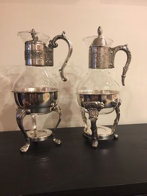 Two Glass Carafes with Warming Stands